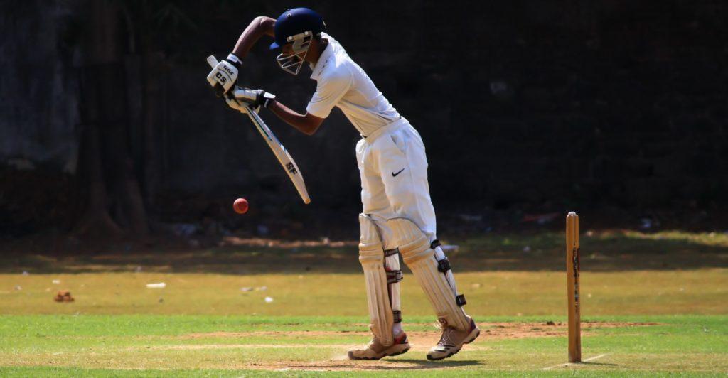 Cricketer playing backwards defensive